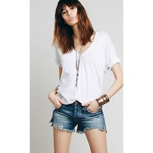 Free People High rise distressed button fly shorts
